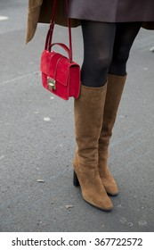 Eva Padberg is pictured during the Mercedes-Benz Fashion Week Berlin Autumn/Winter 2016 at Brandenburg Gate in Berlin, Germany on January 21, 2016. Detail of the red bag and suede boots