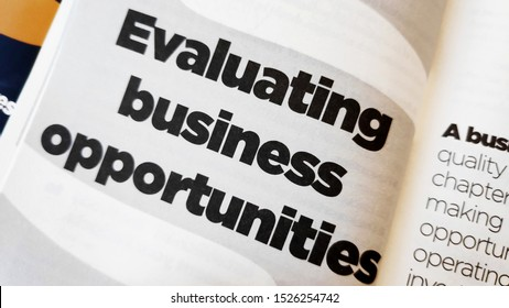 Evaluating business opportunities word printed on a book. Business concept