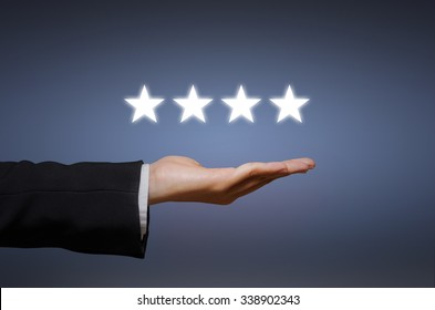evaluation concept. Businesswoman pointing four star to increase rating of company, Increase rating.
