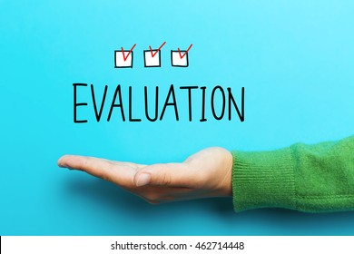 Evaluation concept with hand on blue background