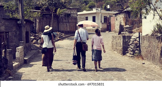Evangelizers of Holy Bible going from house to house / Missionaries in Guatemala / Preaching publically