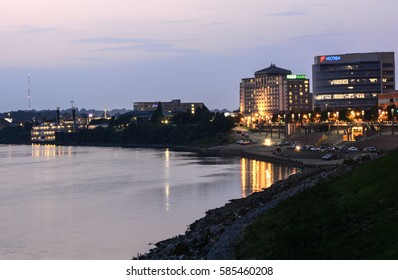 EVANSVILLE, INDIANA - August 5: People relax and talk after sunset near the Ohio River and the downtown business district on August 5, 2014 in Evansville.