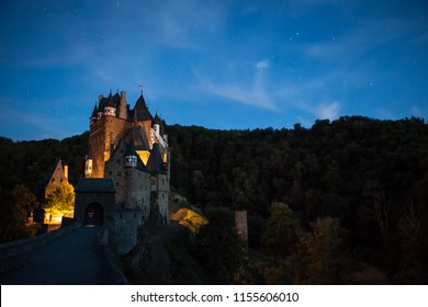 in the eve at the Eltz Castle with a beautiful evening light and stars