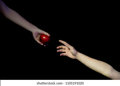 Eve is giving the forbidden fruit apple to Adam on black background