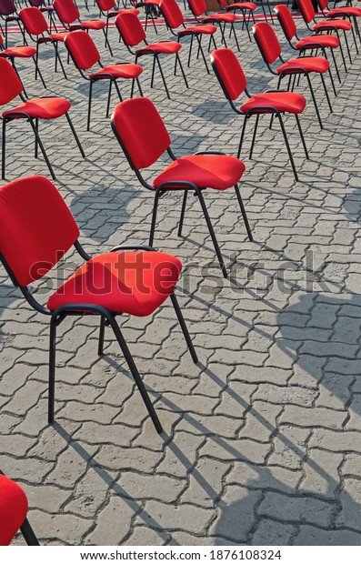 even-rows-red-chairs-stand-600w-18761083