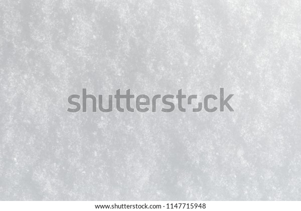 Even snow surface, background, with snowflakes and structure, winter.