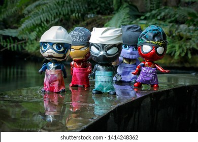 Even though the road was wet after the rain, the Black Panther, Iron Man, Captain America, Spiderman and Thanos left for the Eid Prayer location in Bekasi, West Java, Indonesia, on June 2, 2019.