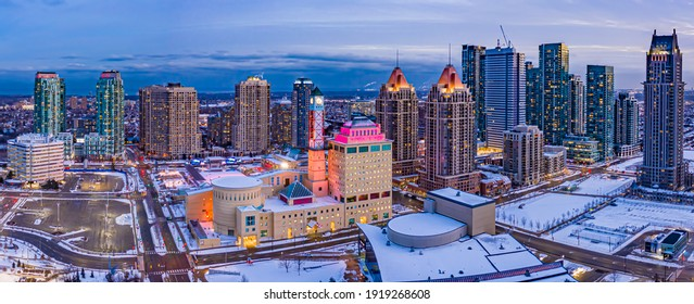 Evening aerial view of downtown Mississauga and Clock Tower in winter.