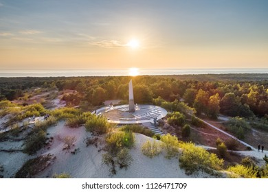 Evening aerial view of sundial constructed on Parnidzio dune in Curonian spit near Nida, Lithuania