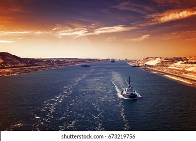 Evening atmosphere in the Suez Canal - a ship convoy passes through the new eastern extension canal, opened in August 2015