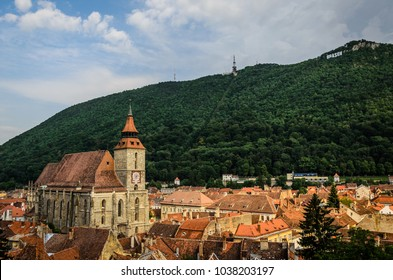 Evening in Brasov city, romania. In the left side of the image is the Black Church and in the background is the Tampa hill with the Brasov letters.