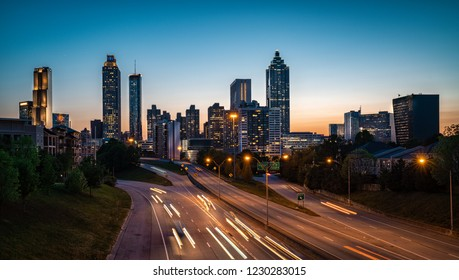 Evening car traffic flowing against city skyline. Late sunset light in the background. Atlanta, USA.