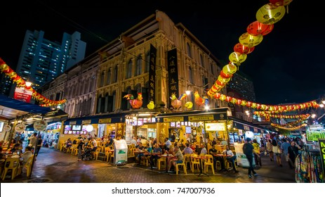 Am evening at Chinatown market, Singapore. I clicked this photo in September, 2017. It captures the essence of the market at Chinatown, with tourists enjoying the local cuisine and souvenirs.