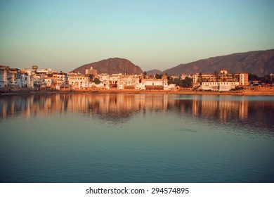 Evening cityscape above holy lake with mountains around, Pushkar city, popular touristic town in Ajmer district of India