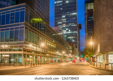 Evening cityscape with car traffic on illuminated street of Frankfurt am Main in dowmtown, Germany