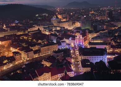Evening cityscape of Ljubljana decorated by Christmas lights with Presern square and Franciscan Church of the Annunciation as seen from Ljubljana castle  in Ljubljana, Slovenia