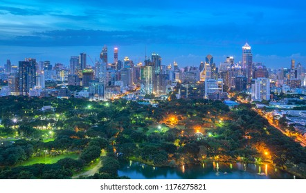 Evening cityscape at Lumpini park from roof top bar on hotel, Bangkok, Thailand