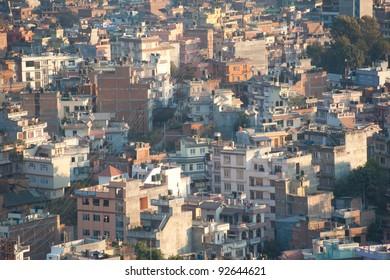 An evening cityscape of many buildings of Kathmandu City, Nepal. View from Swayambhunath pagoda