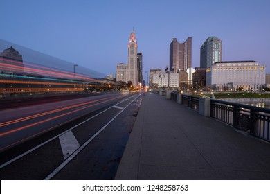 Evening Columbus Ohio skyline along the Scioto River at dusk with car trails