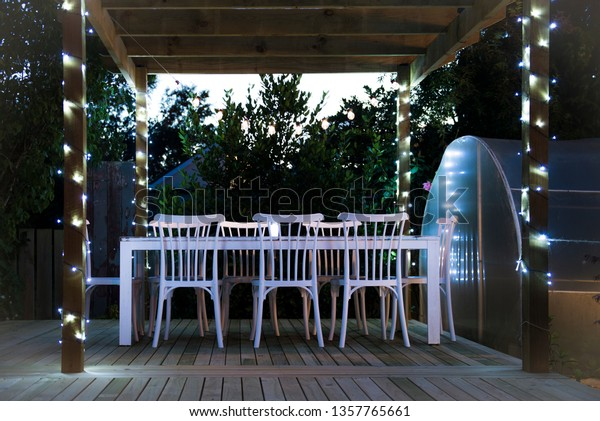 Evening deck scene with fairy lights, Tapanui, New Zealand.