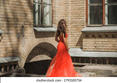 Evening dresses concept, elegant fancy style. Woman in evening red dress. Clothes for ladies, inspiration