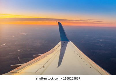 Evening dusk and sunset view with Wing of an airplane
