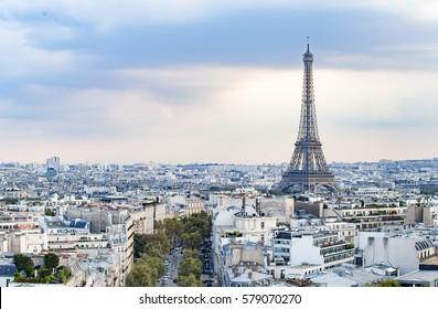 Evening Eiffel tower and Paris city view form Triumph Arc. Eiffel Tower from Champ de Mars, Paris, France. Beautiful Romantic background.