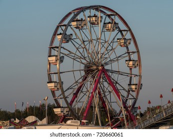 Evening Ferris Wheel At The Amusement Park