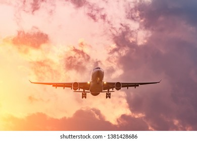 Evening flight, completion of the flight of the aircraft, landing at the airport at sunset and beautiful sky