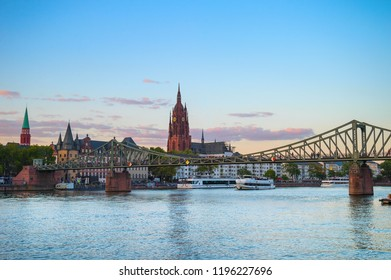 Evening Frankfurt am Main cityscape with Frankfurt Cathedral  and bridge over the river, Germany