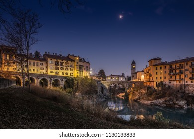 An evening in Ivrea ponte vecchio old bridge, Piemonte, Italy
