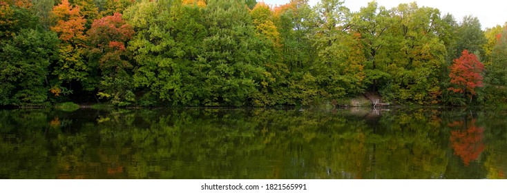 Evening lakeside landscape with autumn colorful trees