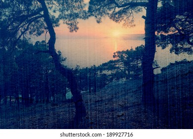 Evening landscape with a beautiful sunset over the sea cape. Crimea, Ukraine, Europe. Filtered image: vintage, grunge and texture effects