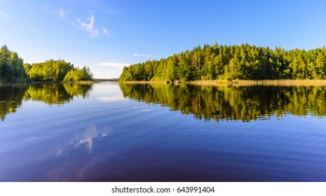Evening landscape lake with reflection. Haukivesi lake, Saimaa lake system, Finland.