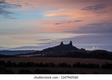 The evening landscape with silhouette of Trosky Castle in summer, Czech Republic
