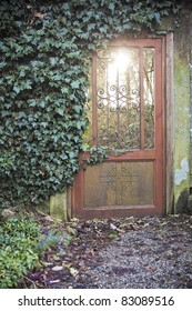 Evening light coming through a doorway in another area of garden at Auchincruive Estate in Ayrshire, Scotland, UK.