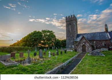 Evening light falls upon St Petrox Church, Pembrokeshire, Wales, UK