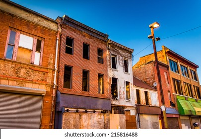 Evening light on abandoned buildings at Old Town Mall, Baltimore, Maryland.