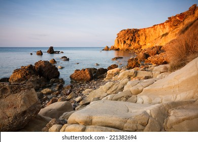 Evening light on a cliff face on Cretan coast, Greece.