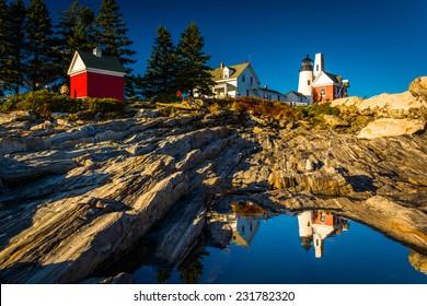 Evening light on rocks and Pemaquid Point Lighthouse, Maine.