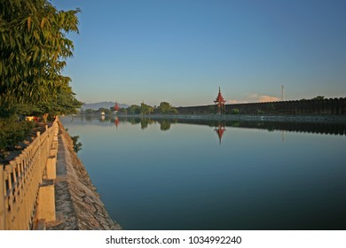 The evening light on the walkway around moat that separates the palace citadel from Mandalay city, Myanmar