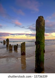 evening light at Youghal Strand, Co.Cork, Ireland showing waves and breakwaters