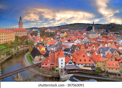 Evening lights illuminate the sky above medieval town of Cesky Krumlov, Czech Republic