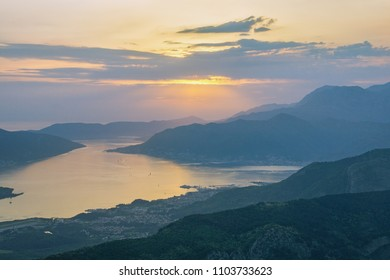 Evening Mediterranean landscape. Sunset. Montenegro, view of Gulf of Kotor (Adriatic Sea) and Tivat city from the Lovcen mountain