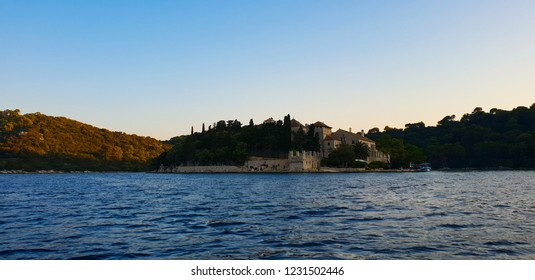 Evening at the Mljet island, Croatia, mediterranean nature and turquoise water during the golden sunset without clouds