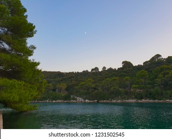 Evening at the Mljet island, Croatia, mediterranean nature and turquoise water during the sunset without clouds