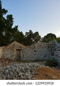 Evening at the Mljet island, Croatia, old wall of stones and mediterranean nature during the calm sunset without clouds
