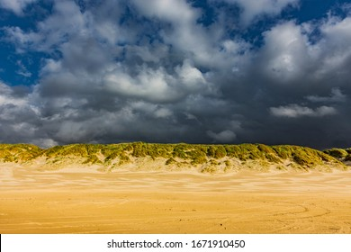 Evening mood with stromy clouds  in dune landscape at Vejers Beach in Denmark  - Shutterstock ID 1671910450