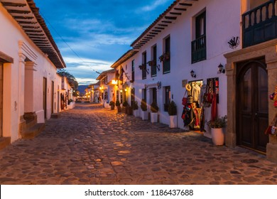 Evening moody view of a cobbled street in colonial town Villa de Leyva, Colombia.