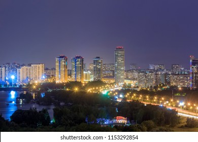 Evening Moscow, Strogino district is an administrative raion of North-Western Administrative Okrug of Moscow, Russia. The lights of the big city. Moskva River. View above.